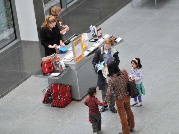 Overhead view of families standing in front of Family Art Kart in Shapiro Family Courtyard