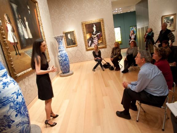 Gallery talk in Sargent Gallery, with women and men seated in front of vases and Boit Daughters painting