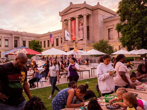 Visitors doing art-making activities outside Huntington Avenue entrance