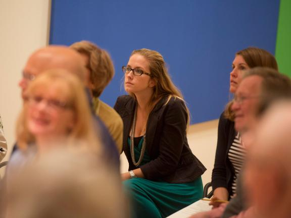 People in Contemporary gallery in front of Ellsworth Kelly piece, seated listening to a talk