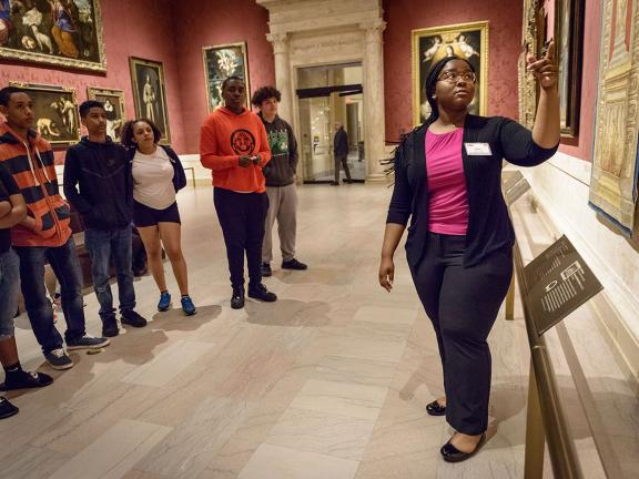 Student docent leading tour in Koch Gallery