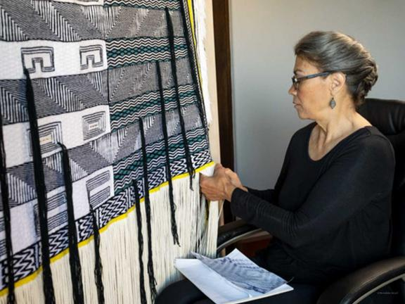 Evelyn Vanderhoop weaving Raven's Tail Robe