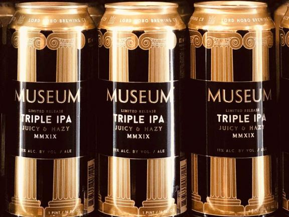 Cans of Lord Hobo's Museum Triple IPA beer