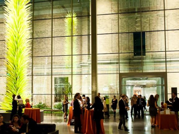 Wide view of attendees in formal evening attire mingling in Shapiro Family Courtyard