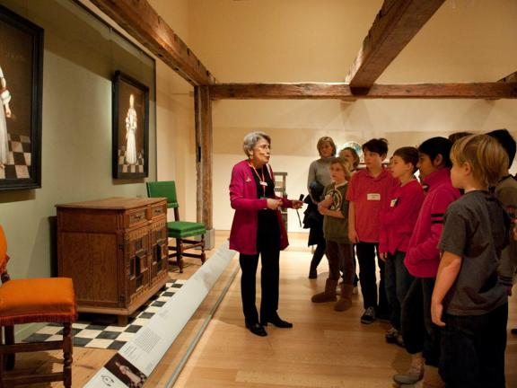 Gallery instructor speaking to school group in Manning House gallery, LG35
