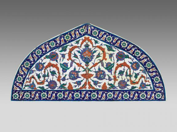 Ottoman tile lunette featuring small tiles in multiple colors