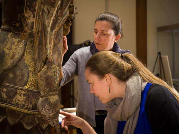 Conservators working on Japanese Buddha sculpture