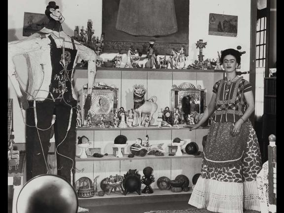 Photograph of Frida Kahlo in Rivera Living Room with Figure of Judas, by Bernard Silberstein