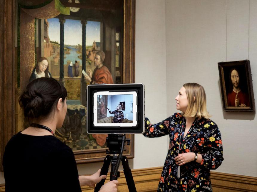 educator describing altarpiece on camera