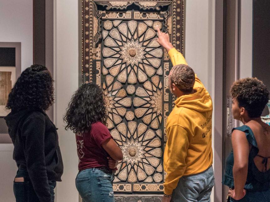 group of college students looking at minbar door