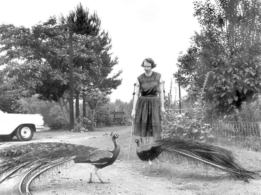 black and white film still of a woman with a peacock