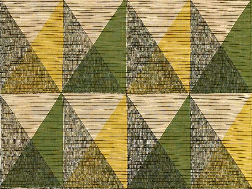 detail of fabric with triangles of various colors arranged neatly in grid