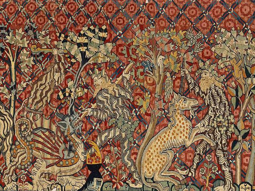 detail of tapestry depicting men fighting dragon and unicorn