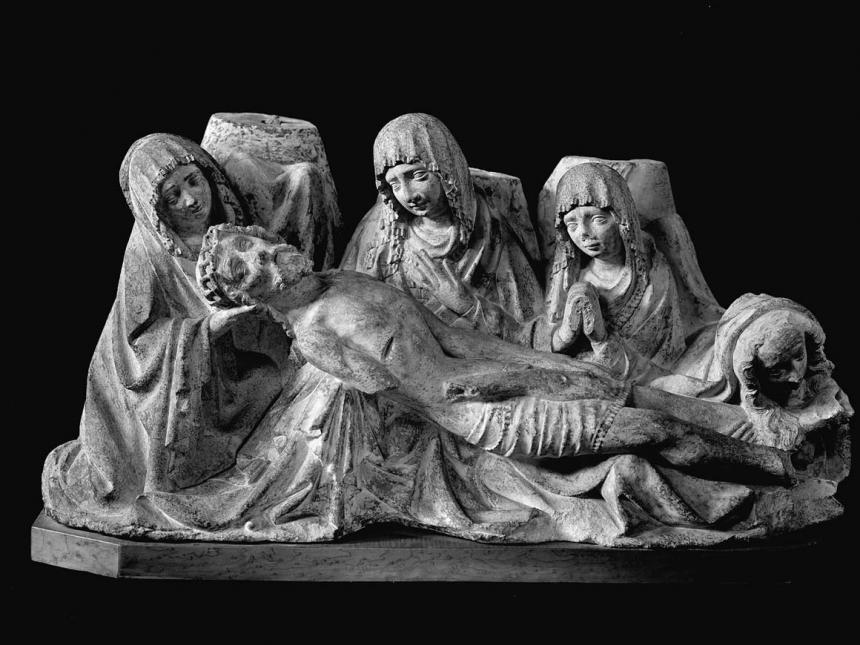 Gothic sculpture of lamentation over body of Christ