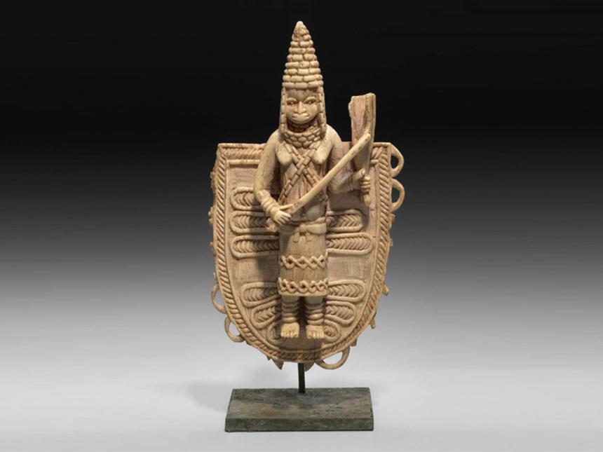 Pendant with a Queen Mother (Iyoba) playing a gong
