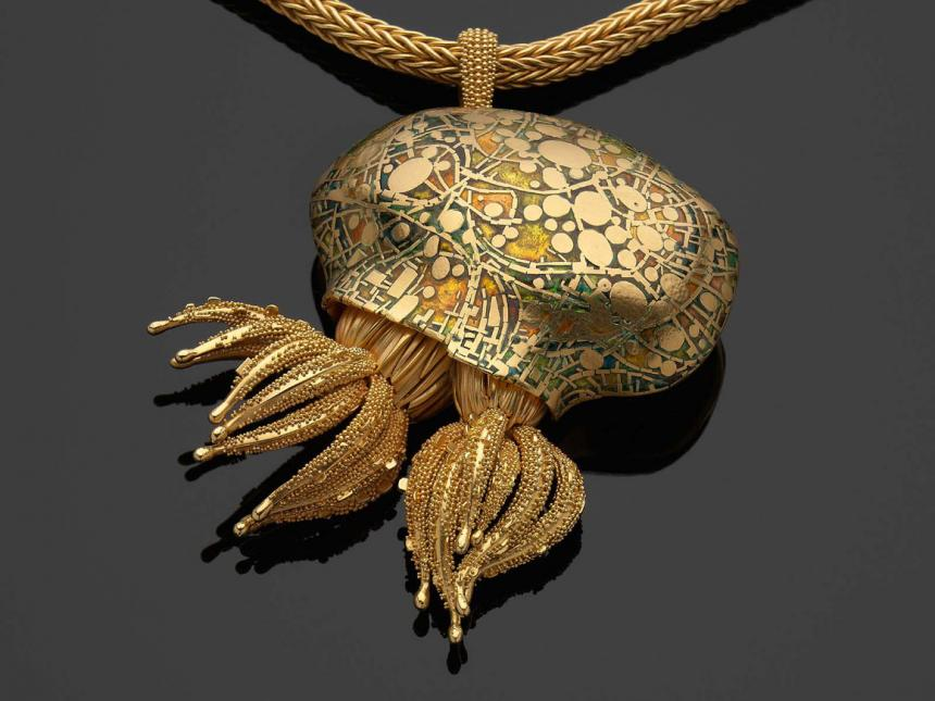 gold pendant in the shape of marine polyp colony
