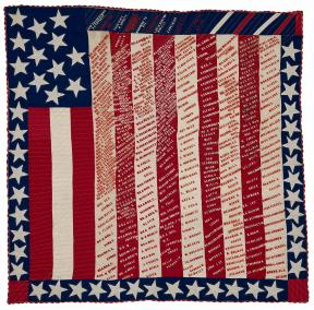 Red, white and blue quilt with stars, stripes and text