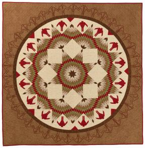 Quilt of browns, reds, and whites with a circle with figures and star shaped patterns