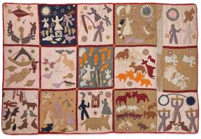 Quilt with different squares depicting human figures and animals