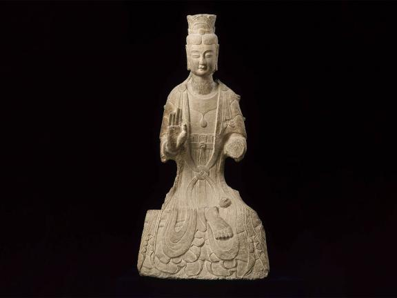 Chinese sculpture of seated bodhisattva with right palm raised