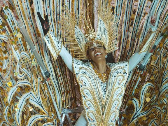 Photograph of woman wearing an elaborate and colorful winged costume
