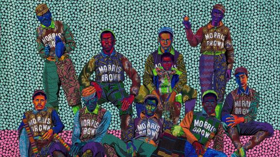 detail of brightly colored quilt depicting a group of young baseball players in uniform