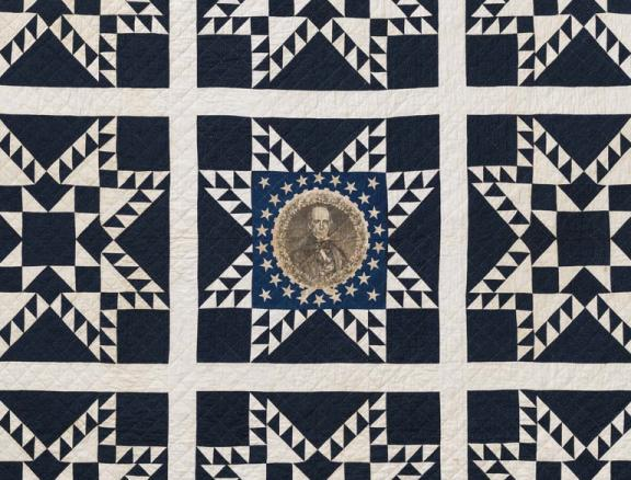 detail of star-patterned quilt with portrait of Henry Clay at center