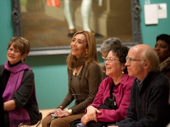 Visitors seated in Art of the Americas Wing gallery during gallery talk