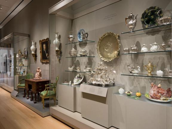 View of display case featuring British decorative arts from 16th through 19th centuries